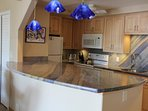 quartzite counters and custom solid maple cabinets and everything you need in the kitchen
