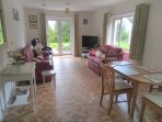 Spacious lounge with TV and DVD player.  Dining table and chairs