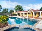 Sunshine Haus has a 40,000 gallon gray bottom pool and hot tub.