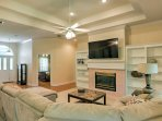 Enjoy lounging on the sectional couch in the living room while smart streaming your favorite shows on the 65-inch...