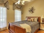 Those sharing this bedroom will look forward to resting their heads on a plush queen bed.