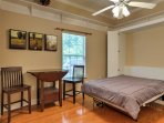 A Murphy bed provides additional sleeping for 2 guests.