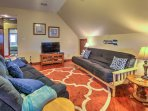 Relax in the living room and watch your favorite shows on the flat-screen satellite TV.