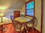 Four guests can eat together at the dining table in the living room.