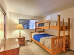 The guest bedroom includes a comfortable twin-over-full bunk bed.