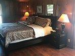 Master bedroom one with large overhead flatscreen TV