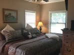 Master bedroom to with large overhead flat screen TV.