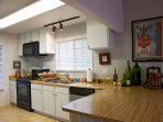 Fully equipped kitchen with dishwasher, microwave and coffee maker