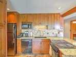 The home's recently remodeled kitchen boasts granite counter tops, wood floors, and all updated appliances.