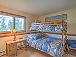 The second bedroom boasts a twin bed bunked over a full bed.