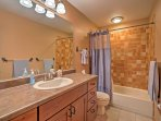 Freshen up in the full bathroom with a shower/tub combo.