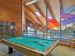 Challenge your partner to a competitive game of pool.