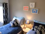 Twin bedroom with a quiet tone of different blues....