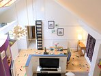 Lofty lounge with enlightened dining area, gallery kitchen and jumble patterned floor