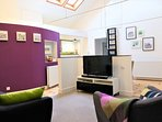 Highlight of purple and green against a neutral backdrop creates a bright and airy ambiance