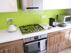 Gallery kitchen well-stocked with equipment , including gas hob, electric stove, dish washer....