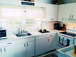 Bright kitchen with new appliances