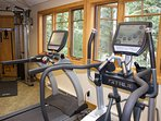 Gym in clubhouse overlooks pool. Bike, treadmill, weights, elliptical, space for yoga.