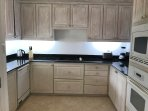 fully equipped kitchen with oven, hob, microwave, dishwasher, washer/dryer