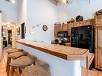 Kitchen has 4 bar stools and raised counter top. Great for breakfast or snack time.