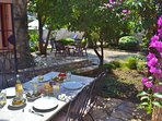 Enjoy dining outside in the lovely private gardens