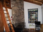Den area: stair ladder, fire place