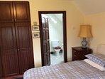 Closets and en suite seen from bedroom #3.