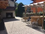 Small sunny courtyard with wood fired hot tub and seating for 10