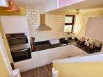 Kitchen: AEG appliances and granite counter
