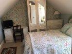 Master bedroom in top floor apt