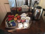 Tea & coffee trays with biscuits, cereals & fresh fruit provided etc