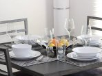 Dining set for four included with property