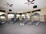 Two level gym with exercise equipment.