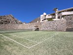 Challenge your partner for a quick game of tennis.