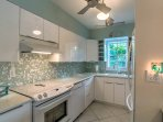 Prepare a meal in the fully equipped kitchen, stocked with all the tools and amenities you'll need.