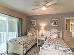 This  second bedroom features 2 twin beds, with charming beach decor.