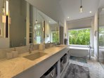 The en-suite master bath features a walk-in shower and spacious tub.