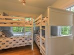 Guests staying on these 4 twin bunk beds will love the views as they drift off to sleep!