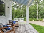 Enjoy your morning coffee on the porch swing, where you can bask in the surrounding natural beauty!