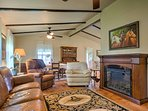Warm up by the fireplace in this cozy 2-bedroom, 2-bathroom Carmine vacation rental cottage.