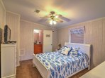 The 'Captain's Quarters' master bedroom features a queen-sized bed.