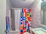 This bathroom features a nautical-themed shower curtain.