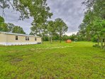 Enjoy a great location on an acre of lush, private property.