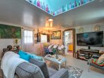 Relax in the home's comfortable furnishings and admire the vibrant decor!