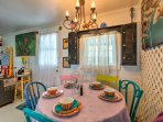 Take a seat at the colorful 6-person dining table for a nice meal.