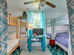 The second bedroom offers 4 bunked twin beds and a flat-screen TV.