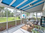 The screened in porch offers another dining table if you want to enjoy your meals outside.