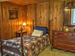 This bedroom offers a twin bed.