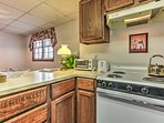 The kitchen boasts updated appliances, wood cabinets, and ample counter space for you to develop mouthwatering...