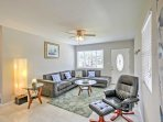 The living room features a plush sofa sectional and a 60-inch flat-screen Smart TV.
